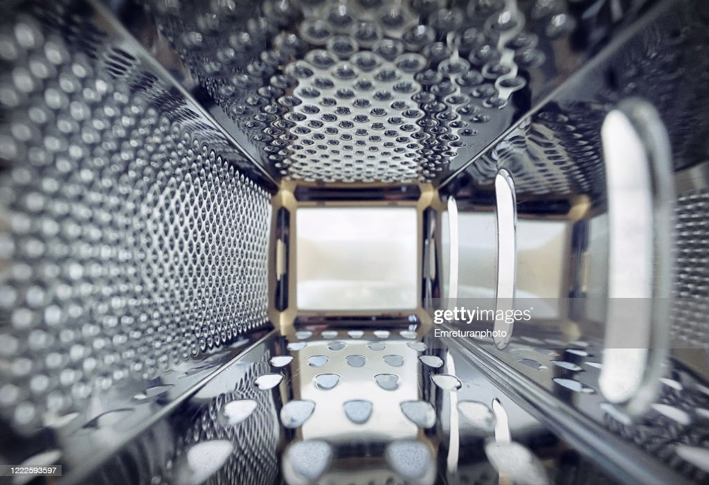 Inner view of a steel grater in the kitchen. : ストックフォト
