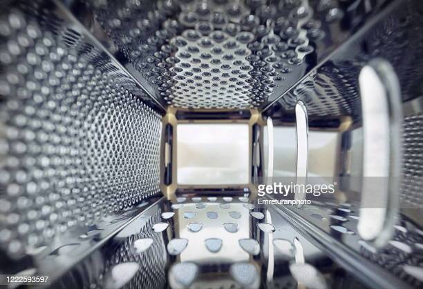 inner view of a steel grater in the kitchen. - emreturanphoto stock pictures, royalty-free photos & images