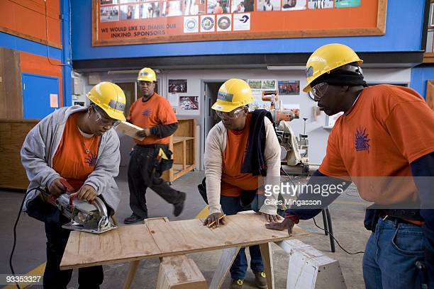 Innercity students work in the Richmond Build classroom where they master basic construction skills before learning how to install solar panels or...