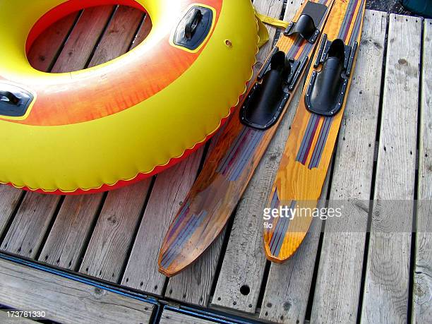 innertube and waterskis - waterskiing stock photos and pictures