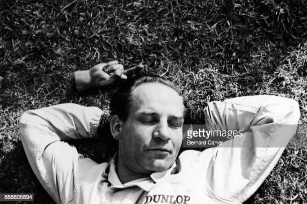 Innes Ireland LotusClimax 24 Grand Prix of France RouenLesEssarts 08 July 1962 Playing jokes on a sleeping Innes Ireland