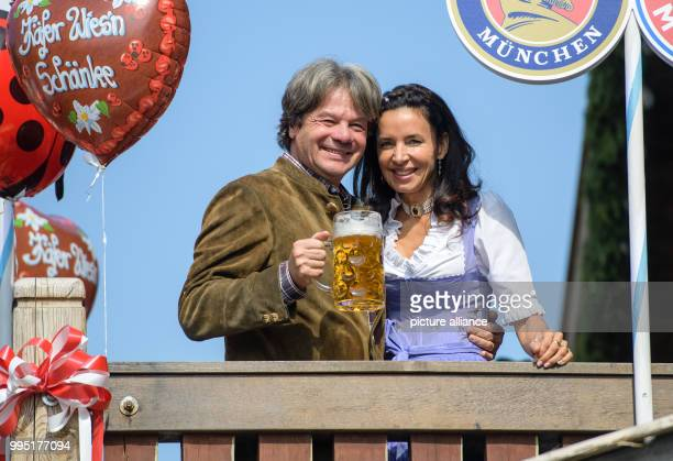Innkeeper Michael Kaefer and his wife Clarissa can be seen on the balcony of the Kaeferzelt tent with his wife Mariann Barrena McClay at the...