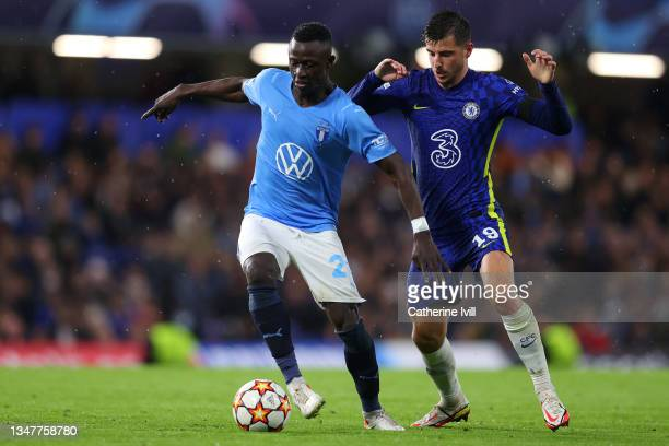 Innocent Bonke of Malmo FF runs with the ball under pressure from Mason Mount of Chelsea during the UEFA Champions League group H match between...
