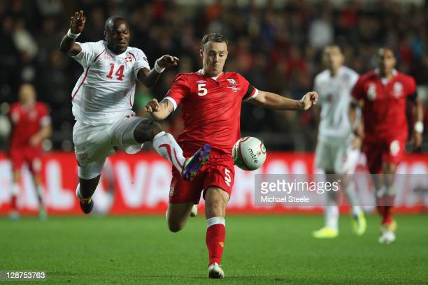Innocent Emeghara of Switzerland challenges Darcy Blake of Wales during the EURO 2012 Qualifying Group G match between Wales and Switzerland at the...