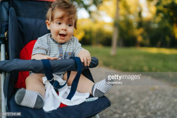 innocent joy - pushchair stock pictures, royalty-free photos & images