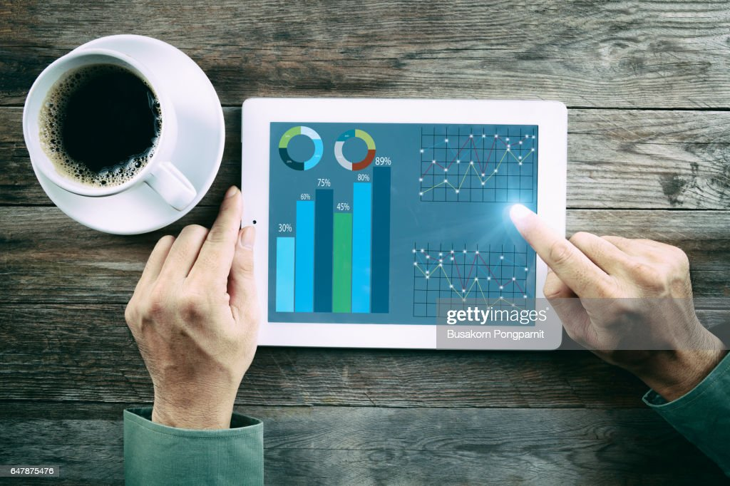 Innovation Start Up Success Growth Concept, hands touch tablet with infographics on the screen, Digital tablet with Finance report charts on screen : Stock Photo