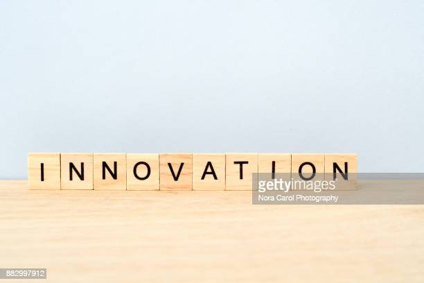 Innovation Word on Wooden Tile Block
