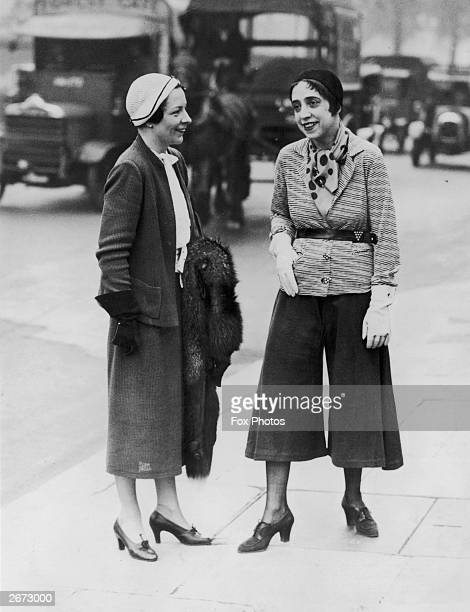 Innovative witty Paris fashion designer Elsa Schiaparelli right in Hyde Park London wearing her 'trousered skirt' and illustrating her current...