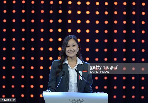 Innsbruck 2012 youth olympian Karina Uzurova speaks during the bid presentation to host the 2022 Winter Olympics in the Kazakh city of Almaty at the...