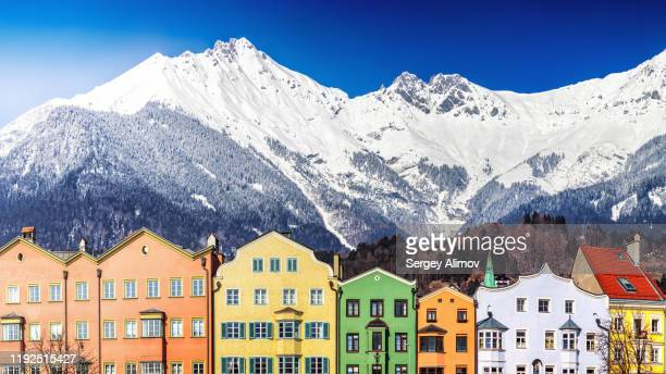 innsbruck traditional buildings and alpine peaks panoramic view - austria stock pictures, royalty-free photos & images