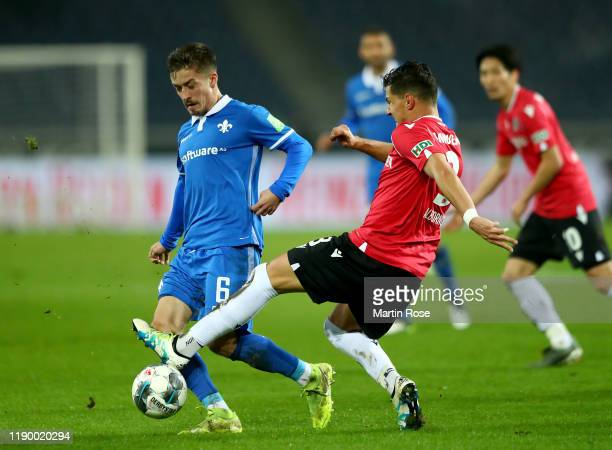 Inola Albornoz of Hannover challenges Marvin Mehlem of Darmstadt during the Second Bundesliga match between Hannover 96 and SV Darmstadt 98 at...