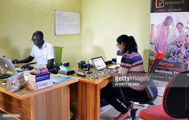 Inoussa Maiga , 30 years old, promoter and founder of the web TV created to promote the talent of young farmers, works in his office with his wife...