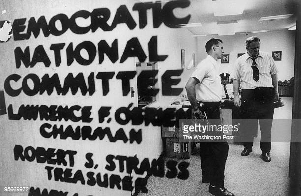Police and telephone men check out the Democratic National Committee headquarters in Washington Saturday after five men were arrested during a...