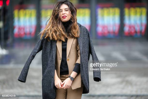 Insaf Bennis fashion blogger from Sparkles in Paris wears a Levi's gray wool coat Apostrophe camel suit and pants Mango black shoes a black top and a...