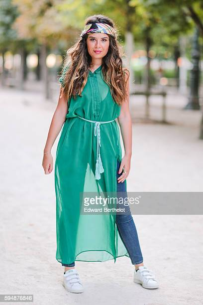 Insaf Bennis is wearing Adidas Stan Smith shoes a green Feel Paris dress Zara blue denim jeans pants and a colorful bandana at the garden Jardin des...