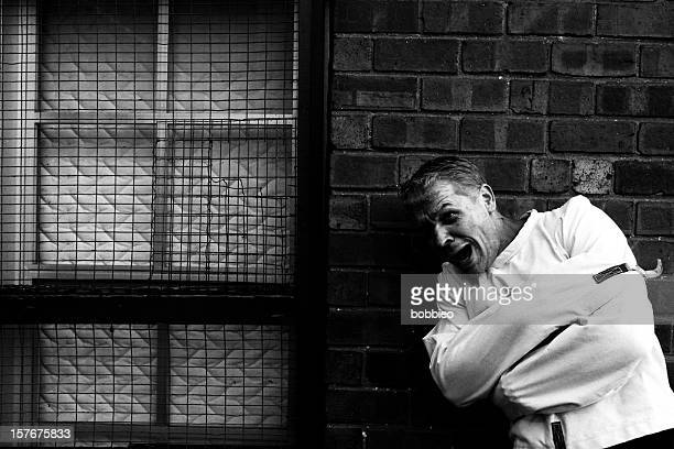 insane man in straight jacket - straight jacket stock pictures, royalty-free photos & images