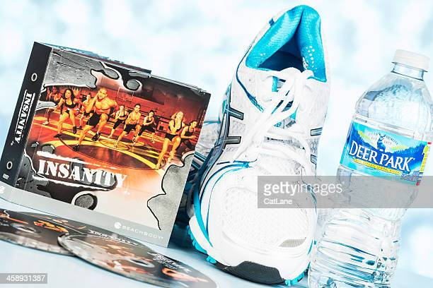 insanity dvds and tennis shoes - insanity stock pictures, royalty-free photos & images