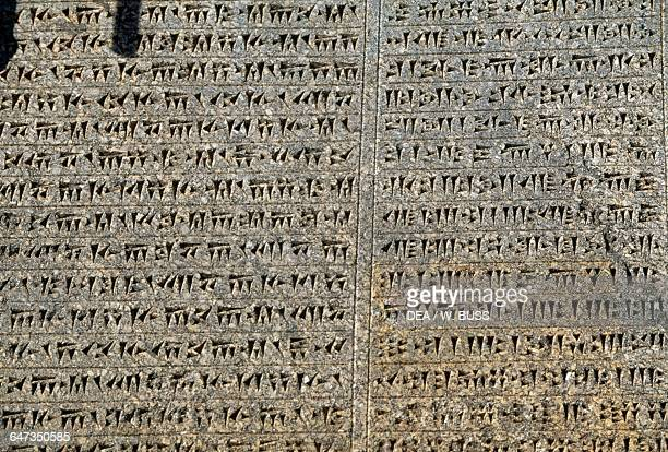 Inscription of Darius I and Xerxes in three languages ancient Persian Elamite and Babylonian detail Ganjnameh near Hamedan Iran Achaemenid...