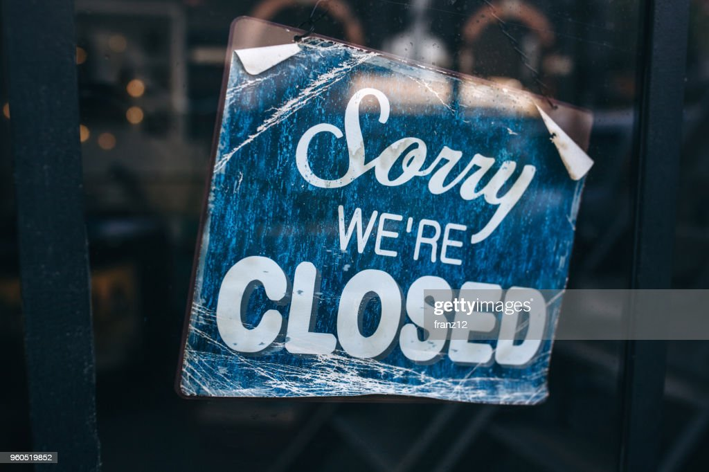 Inscription on a door: Sorry we are closed. Conceptual photo or table on door with information of work. Announcement or work schedule : Stock Photo