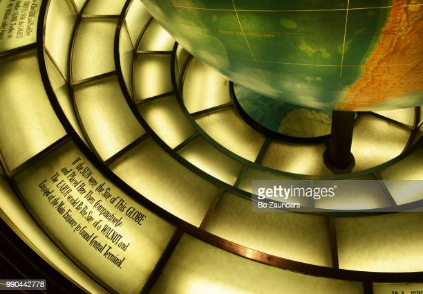 Inscription on the floor beneath the giant Earth globe in the lobby of the Daily News Building in NYC.