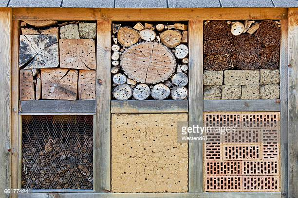 Insect hotel with bricks, wood and pine cones