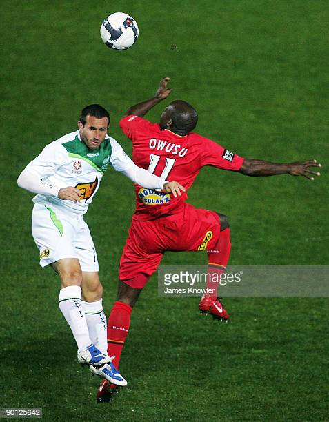 Inseob Shin of Fury head the ball away from Lloyd Owusu of United during the round four ALeague match between Adelaide United and the North...