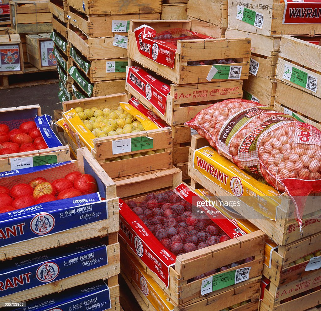 Inside a French M I N  supermarket are piled crates of fruit