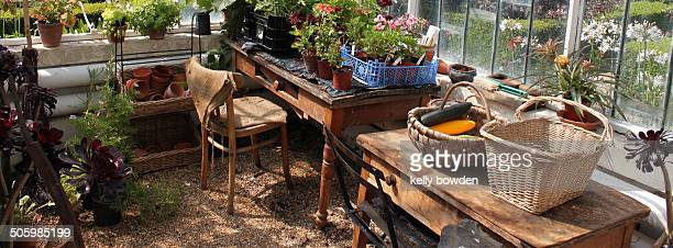 Inside a garden greenhouse with table and chair