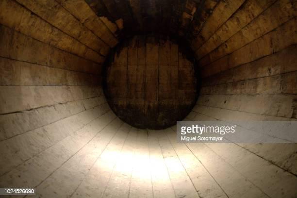 Inside a large barrel