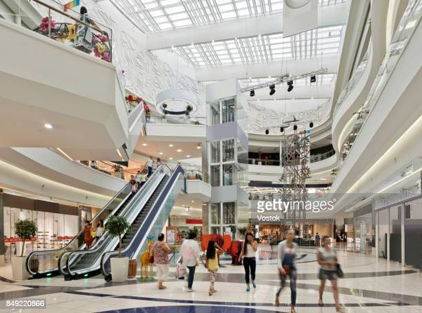 inside a large shopping mall in almaty - shopping mall stock pictures, royalty-free photos & images