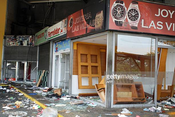 Inside a looted supermarket in Maracay 100km from Caracas on February 25 2014 President Nicolas Maduro convened talks Wednesday with a crosssection...