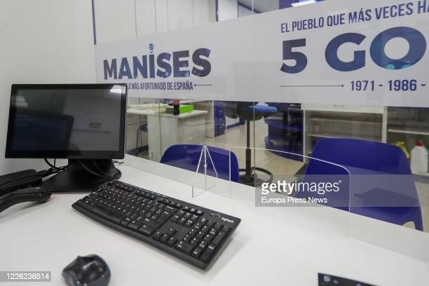 Inside a Lottery Administration in Manises where it reads 'The luckiest people in Spain, 5 Gordos' during the fourth day since the reopening of the...