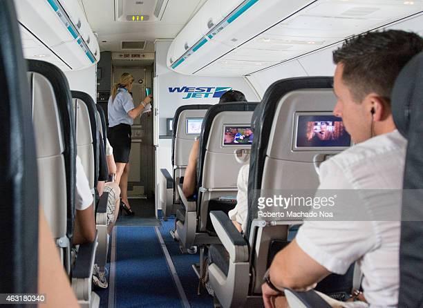 AIRPORT TORONTO ONTARIO CANADA Inside a plane scene of a tourist Westjet flight from Toronto to Cuba
