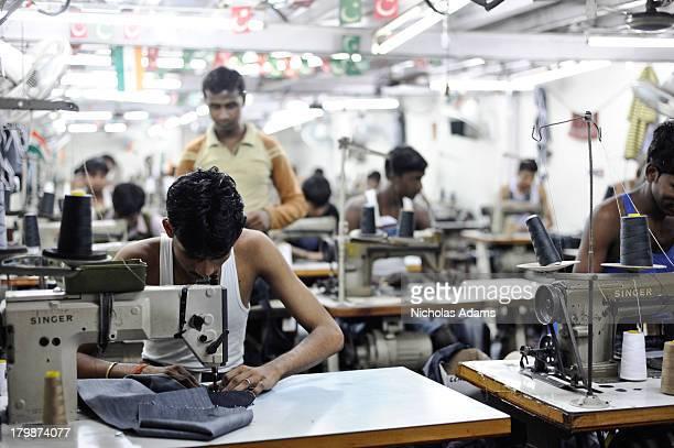 Inside a sweatshop in Dharavi Slum in Mumbai workers produce Jeans for the western market