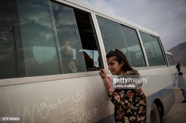 'M' inside bus closes the bus window after kissing her cousin Ranya goodbye as she and her brother Shamoo leave for Germany with a resettlement...
