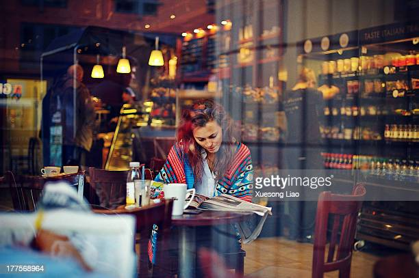 CONTENT] Inside caffe Caffe Nero coffee girl reading newspaper Young lady prettyinside coffee shop