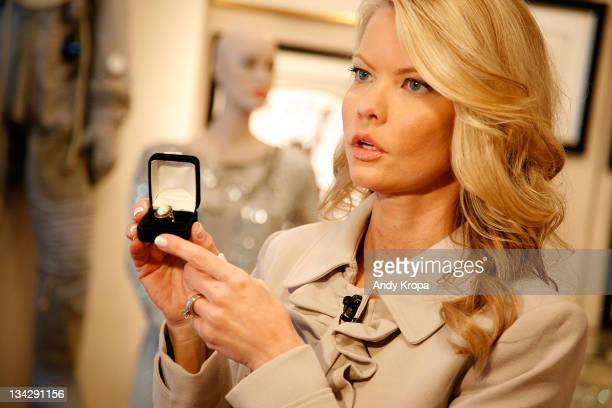 Inside Edition correspondent Diane McInerney holds Sharon Tate's engangement ring from Roman Polanski while reporting on the GOTTA HAVE IT Rock Roll...