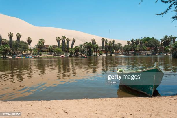 inside huacachina oasis - dunes arena stock pictures, royalty-free photos & images