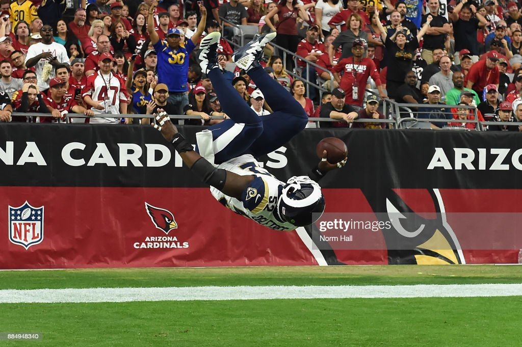 Inside linebacker Alec Ogletree #52 of the Los Angeles Rams flips into the end zone on a 41-yard interception return for a touchdown during the first quarter of the NFL game against the Arizona Cardinals at the University of Phoenix Stadium on December 3, 2017 in Glendale, Arizona.