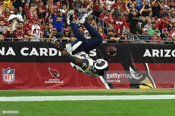 Inside linebacker Alec Ogletree of the Los Angeles Rams flips into the end zone on a 41yard interception return for a touchdown during the first...