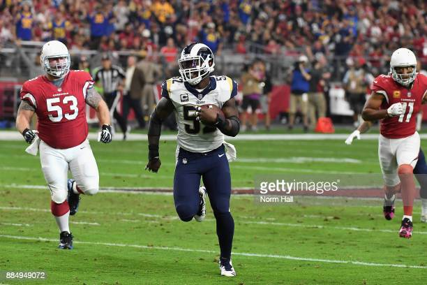 Inside linebacker Alec Ogletree of the Los Angeles Rams returns an interception 41yards for a touchdown during the first quarter of the NFL game...