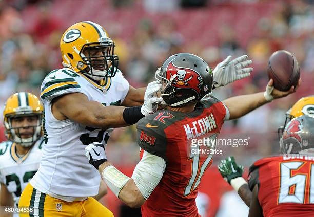 Inside linebacker Brad Jones of the Green Bay Packers puts pressure on quarterback Josh McCown of the Tampa Bay Buccaneers in the fourth quarter at...