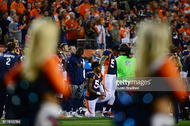 Inside linebacker Brandon Marshall of the Denver Broncos on a knee during the National Anthem before the game against the Houston Texans at Sports...
