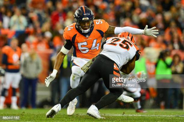 Inside linebacker Brandon Marshall of the Denver Broncos sets to tackle running back Giovani Bernard of the Cincinnati Bengals at Sports Authority...