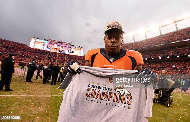 Inside linebacker Brandon Marshall of the Denver Broncos shows off the AFC champions tshirt after the Broncos defeated the Patriots 20 to 18 winning...