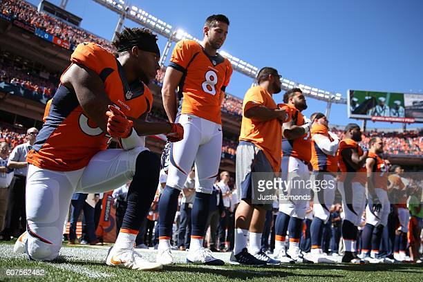 Inside linebacker Brandon Marshall of the Denver Broncos takes a knee during the National Anthem before the game against the Indianapolis Colts at...