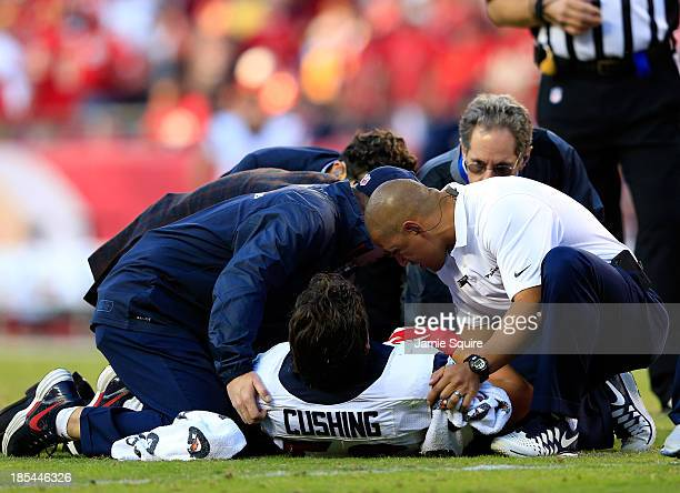 Inside linebacker Brian Cushing of the Houston Texans is attended to after being injured during the game against the Kansas City Chiefs at Arrowhead...
