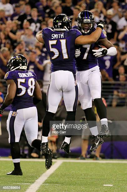 Inside linebacker C.J. Mosley of the Baltimore Ravens celebrates his fumble recovery with inside linebacker Daryl Smith of the Baltimore Ravens at...
