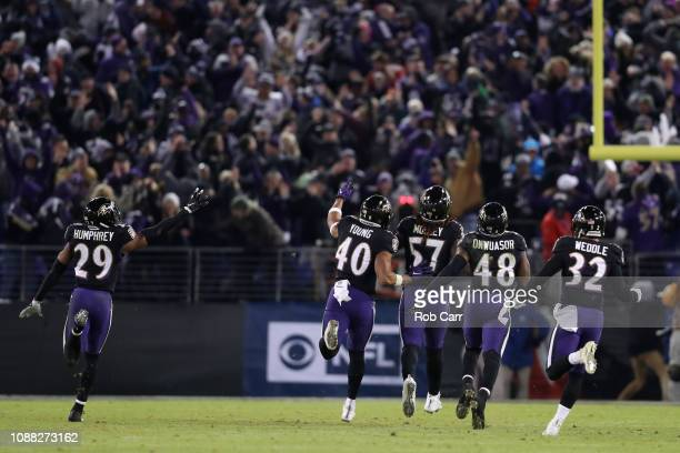 Inside Linebacker CJ Mosley of the Baltimore Ravens celebrates with teammates after an interception in the fourth quarter against the Cleveland...