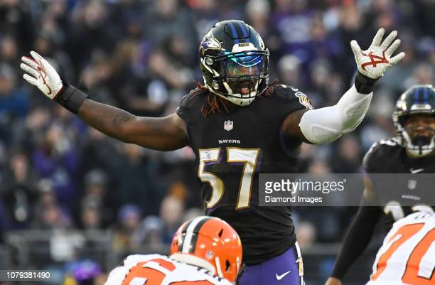 Inside linebacker CJ Mosley of the Baltimore Ravens gestures to the defense in the first quarter of a game against the Cleveland Browns on December...